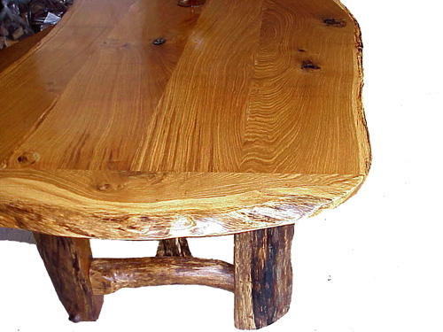 Solid, finely finished oak top and legs. It's ALL oak.