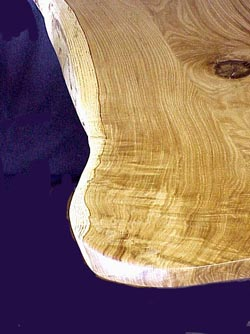 The swirling clowing wood grain of Kansas Burr Oak.